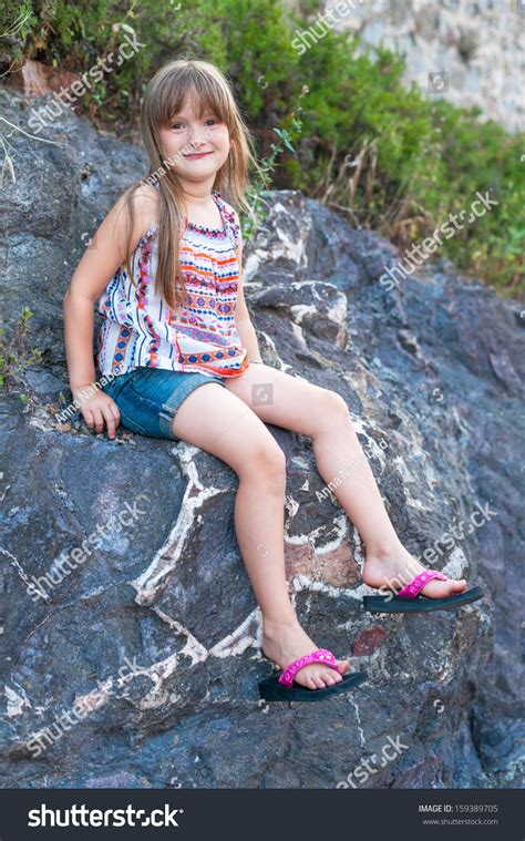 young teen little girls shorts cute little girl sitting on a bid rock wearing colorful