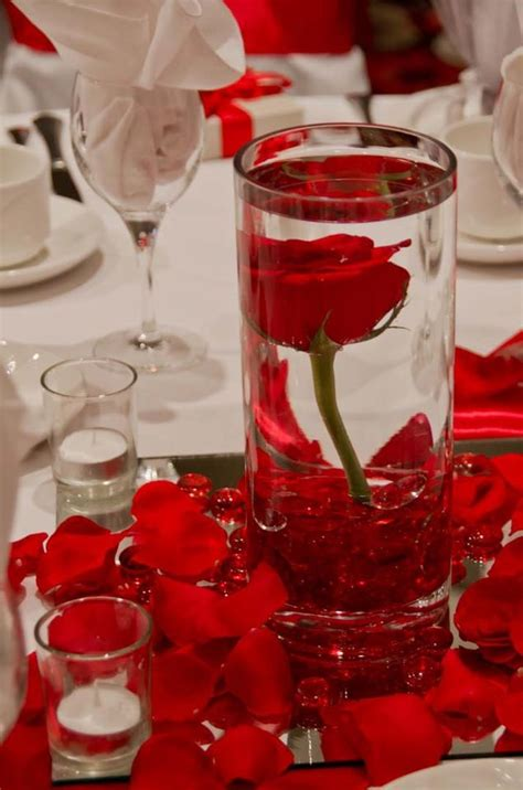 rose themed quince submersed red rose centerpiece flamenco quinceanera
