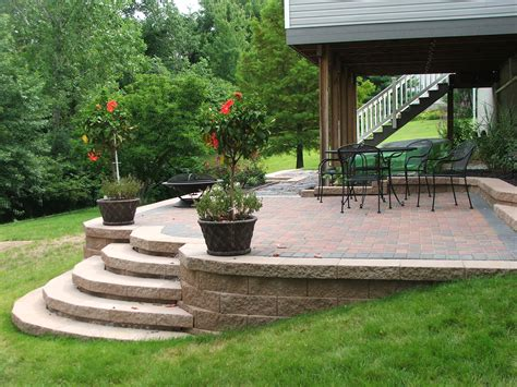 Paver Patio With Retaining Wall Patio Deck On Pinterest Raised Patio Concrete Patios And Patio