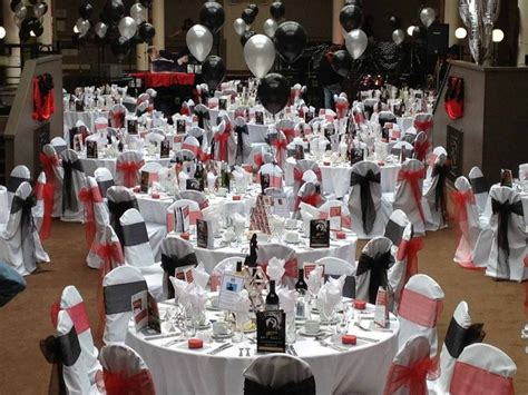 themed charity events james bond themed event balloons and pops of red 007