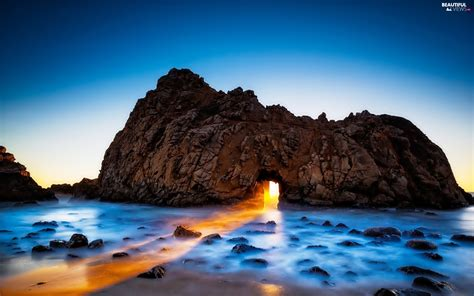 California Light by California Light Breaking Through Sky Sea Rocks