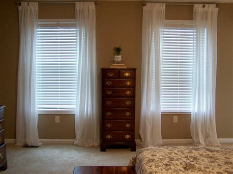 long curtains short window traditional bedroom with short window long curtains and