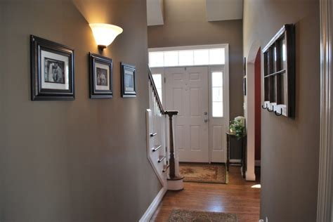 Hallway Color Ideas Painted The Hallway Quot Bison Beige Quot And Added Family Pictures To Give Our Entry Way A More
