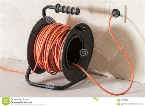 extend electrical wire orange electrical extension cord stock photo image