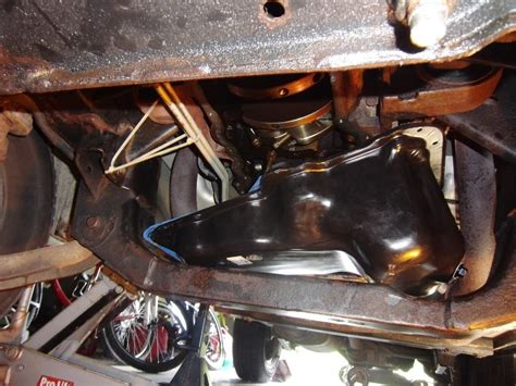 how to remove a oil pan on a removing an oil pan from a kj jeep liberty without removing or lifting the engine the doom