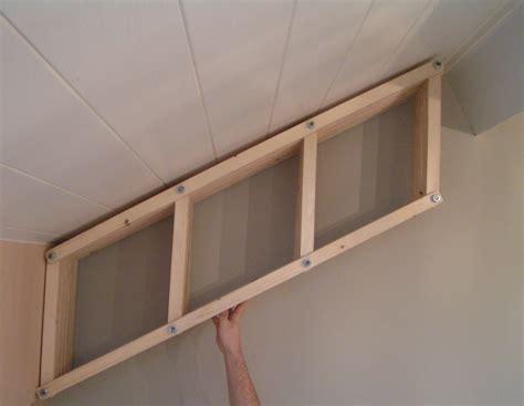 adjustable bookshelf  angled walls  pictures