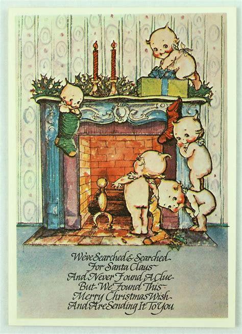 kewpie hanging stockings by fireplace vintage christmas