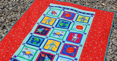 Mooi Playmat Sky Rocket Blue made by chrissied the rockin robot laminate backed picnic playmat