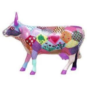 cow figurine and patchwork on