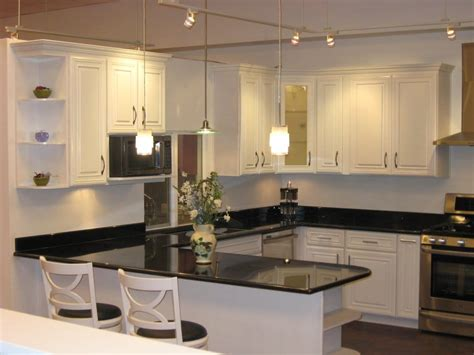 white kitchen cabinets black granite white ivory maple cabinets with black galaxy granite yelp