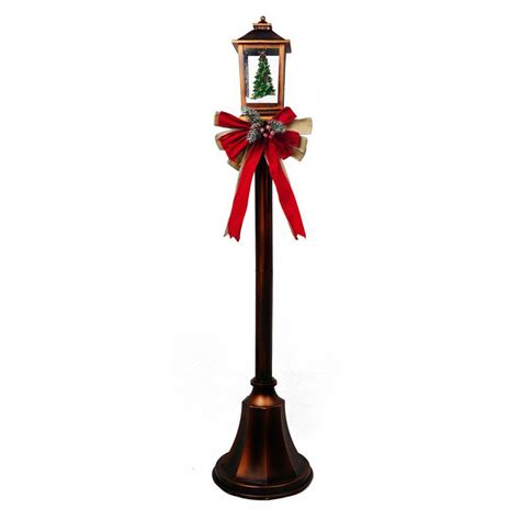 christmas l post with blowing snow home accents holiday 56 in christmas lpost with snow