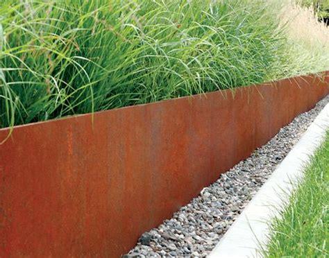 corten steel planter retaining wall close up garden