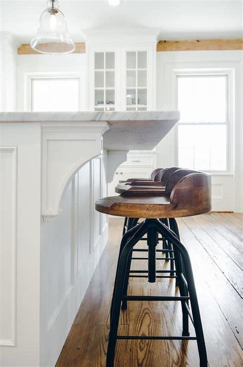 kitchen island corbels gray wash wood island stools transitional kitchen