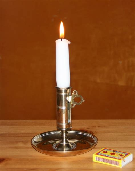 White Candlestick Holders by Candle