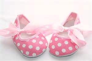 newborn baby crib shoes in pink with white polka dots and