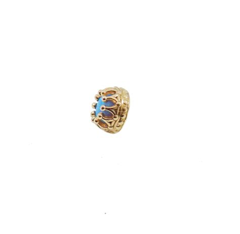 Blue Opal 01 crown end in blue opal and yellow gold identity
