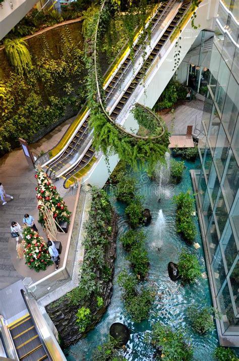 green vertical interior design  emquartier shopping mall