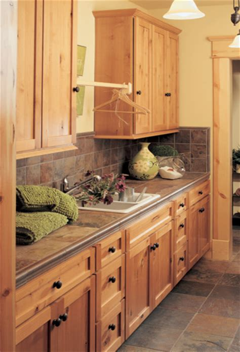 rustic cabinets for laundry room canyon creek cornerstone shaker in rustic alder in a