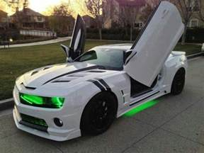 white camaro with black racing strips neon green lights