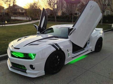 neon green camaro white camaro with black racing strips neon green lights