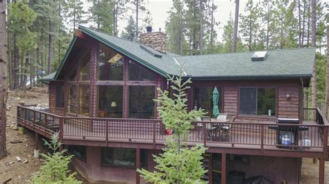 2 688sf mountain cabin on 2 4 ac in the pines high