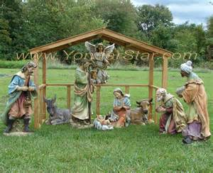 Outdoor nativity scene with wooden manger 3 gif