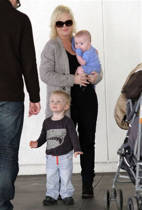 amy poehler sons amy poehler and family arriving on a flight at lax zimbio
