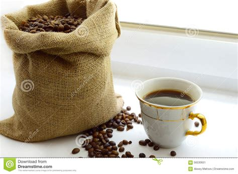 Black Coffee Aromatic cup of aromatic coffee and coffee beans stock photo