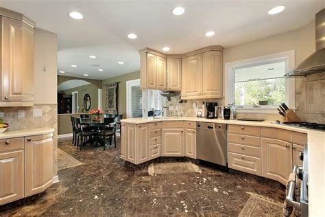 dark kitchen cabinets with light floors dining room with white wall tiles kitchen with dark