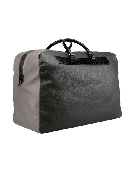 Roberto Cavallis Has Packed Bags by Lyst Class Roberto Cavalli Travel Duffel Bag In Green