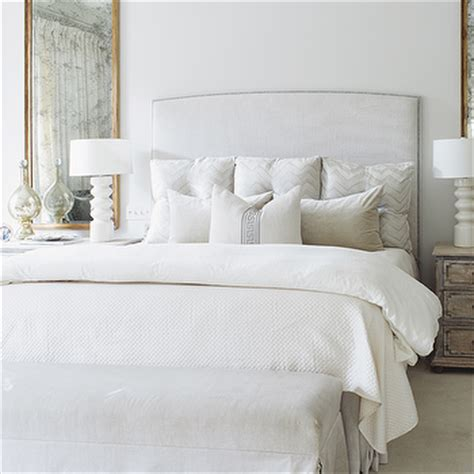 gray and gold bedroom with gold mirror headboard