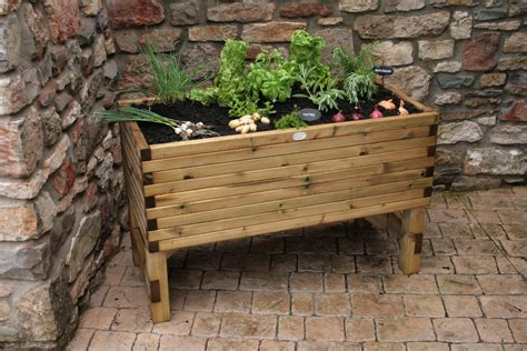 Raised Planters For Vegetables by Raised Vegetable Planter Pressure Treated Planters Svw