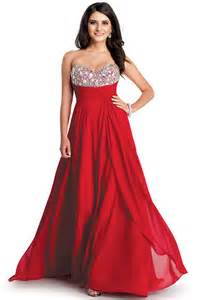 Always a strong colour a red dress dominates any room and we love