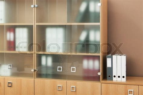 office bookcase with glass doors bookcase with glass doors in a modern office stock photo