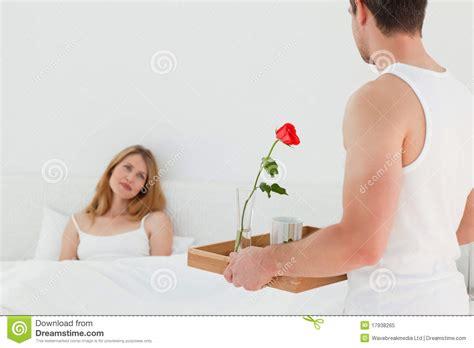 lovers in bed joyful lovers having breakfast in their bed royalty free