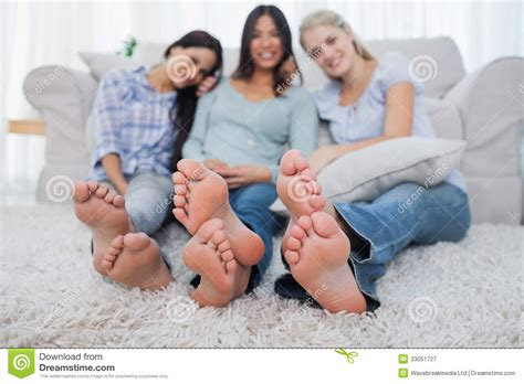Couch Floor Plan by Friends Relaxing On Floor And Smiling At The Camera