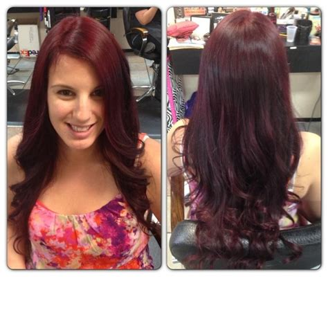 burgundy highlights on shag haircuts burgundy hair with layers done at shag me salon las vegas