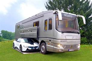 volkner rv bespoke rv hides sports car in mobile garage curbed