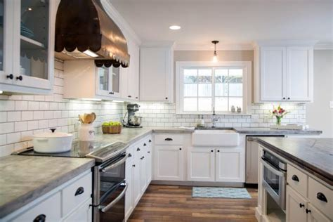 kitchen with white cabinets and copper vent hgtv