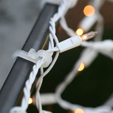 christmas light hanging ideas from gutters how to hang lights on gutters