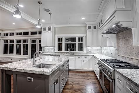 white kitchen cabinets with granite kitchen with granite counters and a white finish griffin