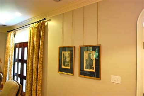 hang pictures interior design musings picture hanging details