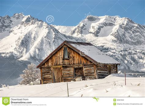 Snowy Mountains Cottages by Winter Cabin And Idaho Mountains Stock Photos Image