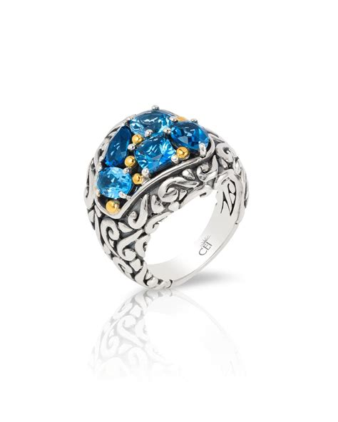 sterling silver 18k yellow gold blue topaz ring