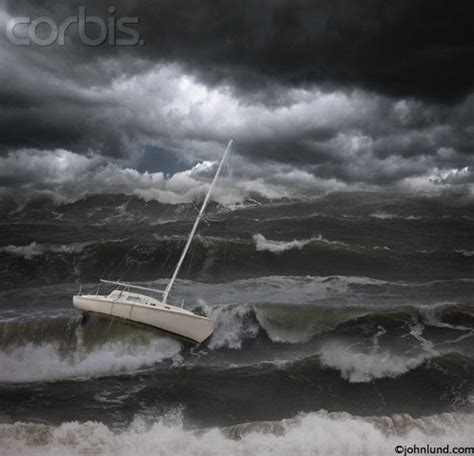 small boat in big waves concept stock photo of a small sailboat being violently