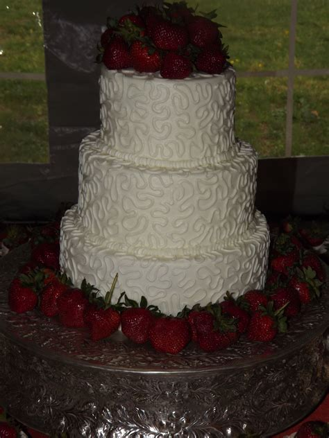 Chantilly lace wedding cake decorated with strawberries