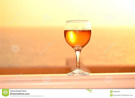 Kaos Wine Cocktails 17 Oceanseven white wine glass on a sunset background stock photo image 39805039