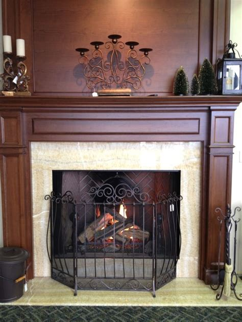 gas fireplace with wood mantel traditional living room