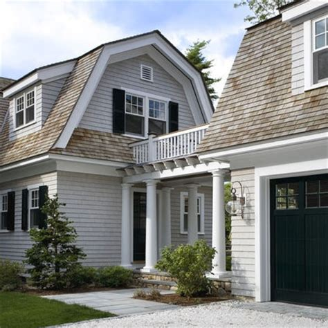 light grey cape cod with white trim black shutters and doors exterior
