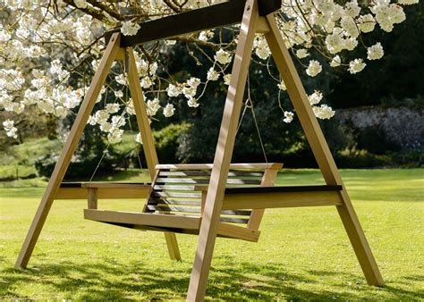 swing in the garden garden swings the enchanting element in your backyard